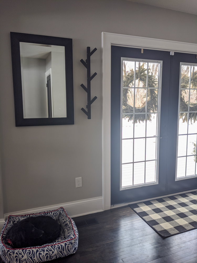Two ingredients of a great entryway? A place for coats and a mirror. And I'm happy to report that those two things went up this weekend!