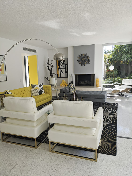 How lovely is this yellow living room? We were so lucky to stay in such an inspiring midcentury home while we visited Palm Springs. Click to see some of my favorite angles of this home.
