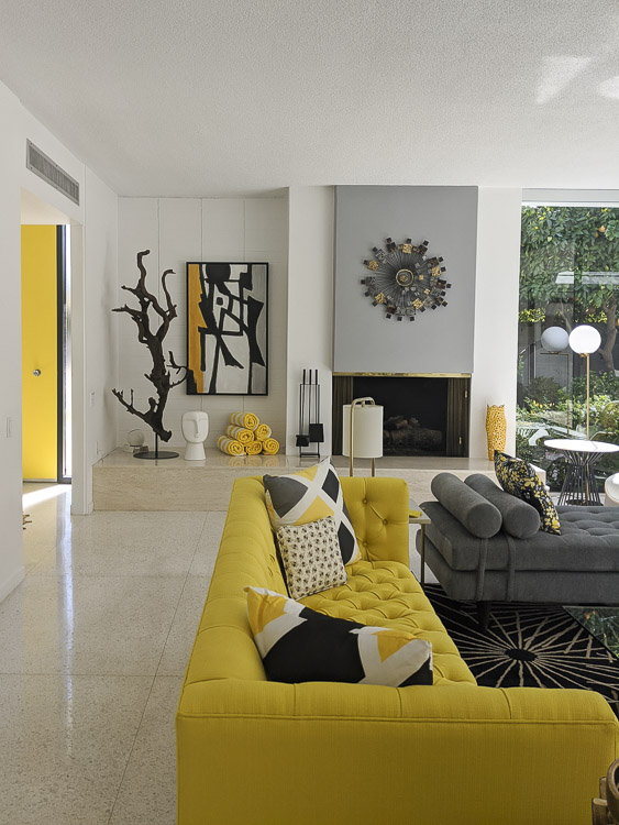 Pops of yellow in this midcentury modern living room in Palm Springs were so bright and cheery! Click to see even more inspiration in this vacation rental home.