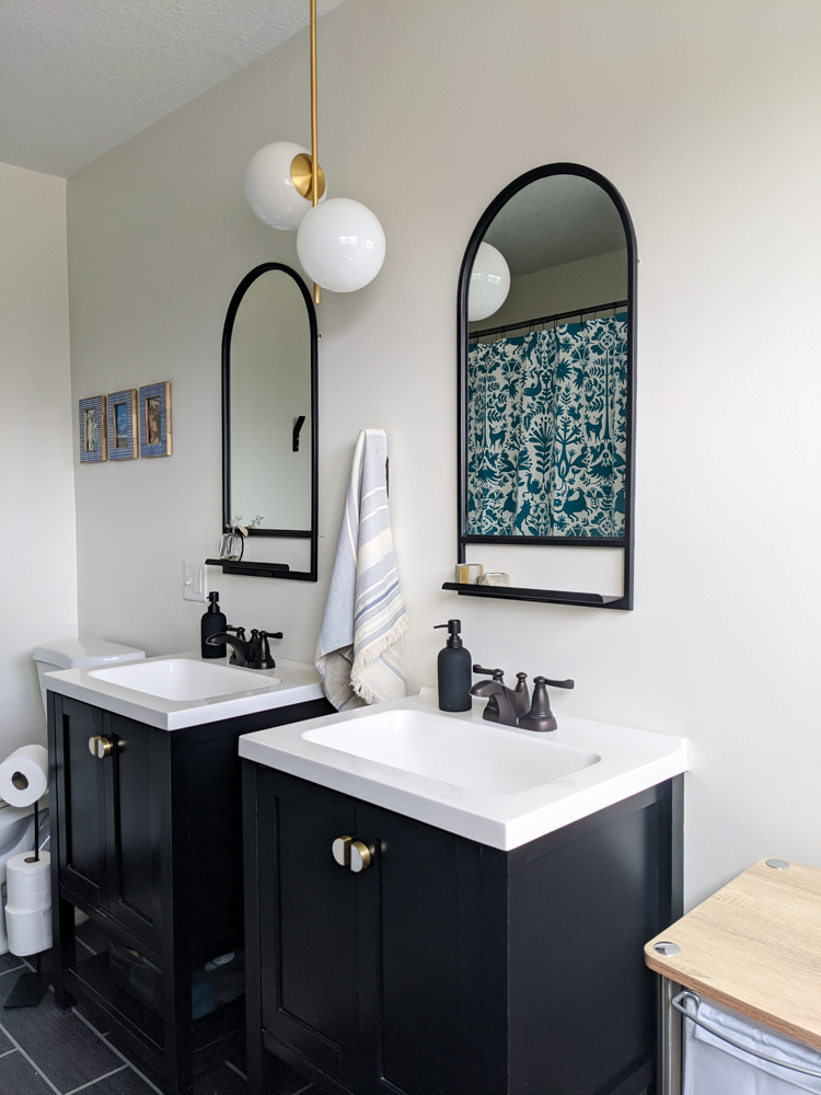 While we're stuck inside for social distancing we decided to take on our guest bathroom and give it a little contractor-free facelift. The changes we made completely changed the feel of the room without having to hire a single contractor, plumber, or electrician. Click to see the reveal!