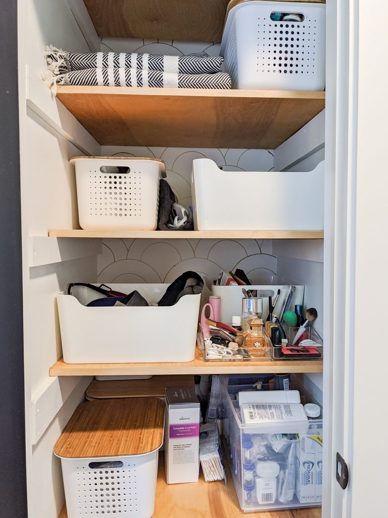 We couldn't just have a pretty space—it had to function, too. Today, I thought I'd share the storage solutions we came up with, as well as some ideas for organizing your own bathroom and/or linen closet.