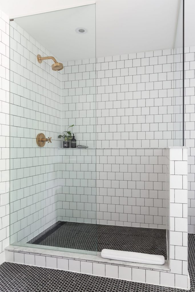 Shower storage is obviously crucial, but should we go with a shower ledge? Click to see the options we're debating and weigh in.