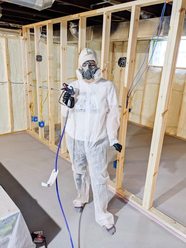 Do you need personal protective equipment while spraying paint with a sprayer? Today I'm covering why you might and how I stayed safe while painting my basement ceiling. Click to read!