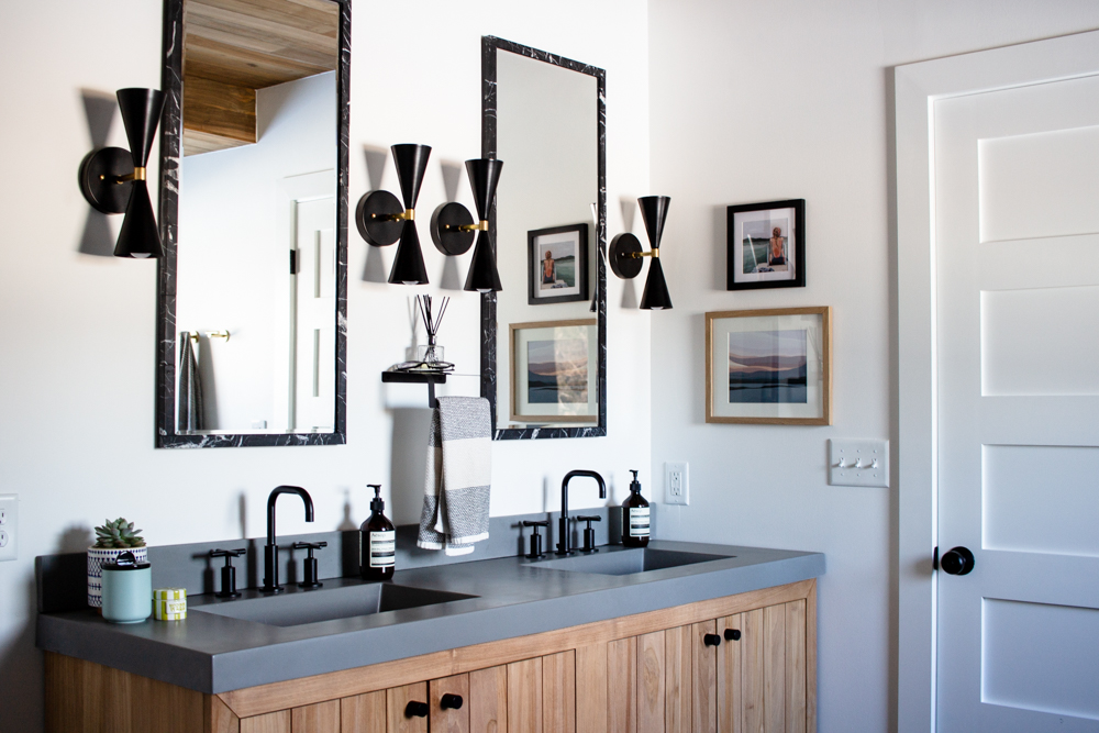 It's finally time to share our black and white bathroom (with lots of wood accents). It was a long time coming, but we're so pleased with the result. Click through to see more and shop every single source.