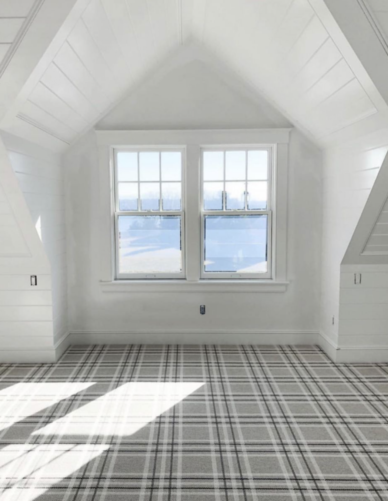 When I started finding images of plaid wall-to-wall carpet, it alternated between feeling like a bold choice and blending to practically become a neutral. Click to see more plaid carpet inspiration, from basements to living rooms to stairs.